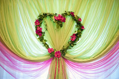 Wedding hall decoration. Pink and light green curtain made of transparent chiffon, decorated  leaves heart-shaped Royalty Free Stock Image