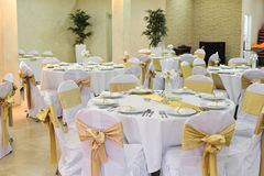 Wedding Hall Setup. Tables and chairs in a wedding hall ready to accept guests Royalty Free Stock Images