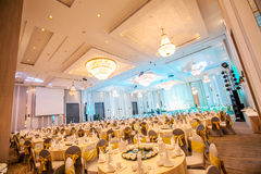 Wedding hall. Wide, spacious and stylish wedding or special events hall with chandeliers stock photography