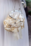 Wedding handbag of the bride. Open bridal purse and hair clip Royalty Free Stock Images