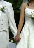 WEDDING HANDFASTING CEREMONY. Hands tied at wedding handfasting ceremony stock photo