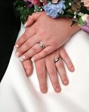 Wedding hands. Husband and wife with hands and wedding rings together Royalty Free Stock Images