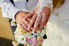 Wedding Hands. Wedding Bouquet with hands and rings Royalty Free Stock Photos