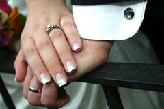 Wedding Hands. A bride and Groom's hands with bouquet of flowers Royalty Free Stock Image