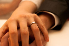Wedding Hands. A newly married couple holding hands, with wedding ring on display Royalty Free Stock Image