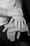 Wedding Hands B&W. A closeup of a newly married couple's hands, displaying their rings royalty free stock photography