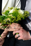 Wedding hands bouquet Stock Image