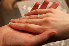 Wedding. Hands of bride and groom Stock Photography
