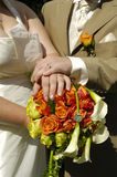 Wedding hands and flowers. Wedding couple showing hands and flowers Royalty Free Stock Photos