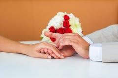 Wedding hands. Groom is holding hand of bride Stock Images
