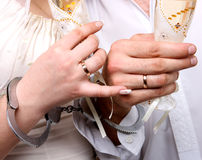 Wedding. Hands in handcuffs newlyweds Stock Image
