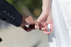 Wedding hands. Man and woman making a pinkie promise Royalty Free Stock Photo