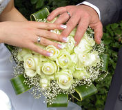 Wedding hands and rings on flowers Stock Photo