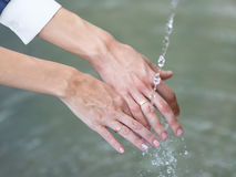 Wedding hands under running water Royalty Free Stock Photo