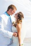 Wedding - happy bride and groom kissing Stock Photos
