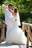 Wedding - happy bride and groom kissing Royalty Free Stock Images