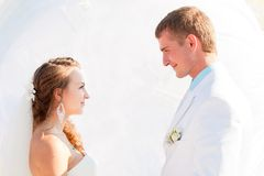 Wedding - happy bride and groom look at each other Stock Photos