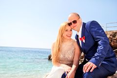Married couple sat smiling to the sea Royalty Free Stock Photo