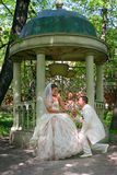 Wedding.Happy couple near an arbor in park Royalty Free Stock Images