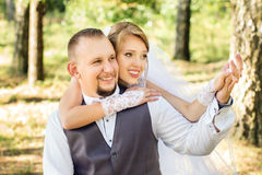 Wedding, happy young couple in the forest Stock Images