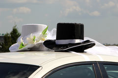 Wedding hats on the car roof stock photos