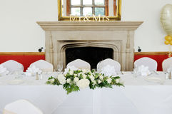 Wedding head table. Top table at wedding reception decorated with white floral arrangement Stock Photography