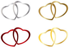 Wedding heart rings. Four different colors wedding heart rings, gold, silver, bronze and red Royalty Free Stock Photo