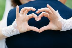 Wedding heart with your hands Love to her husband. Marriage companionship. love behind your back. Family support and relationships stock image