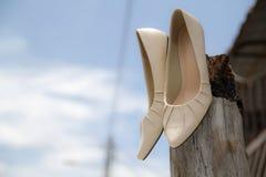Wedding heel on a tree wood with sky background Stock Photo