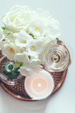 Wedding home decor. Bouquet of white flowers in a vase, candles and champagne on a copper tray vintage, wedding home decor stock photography