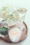Wedding home decor. Bouquet of white flowers in a vase, candles and champagne on a copper tray vintage, wedding home decor stock image