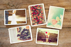 Wedding and honeymoon instant photo album on wood table. Paper photo of film camera - vintage and retro style Stock Images