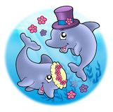 Wedding image with dolphins in sea Royalty Free Stock Images