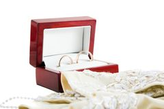 Wedding ings and gloves. Wedding ings in wooden box and gloves isolated Stock Photo
