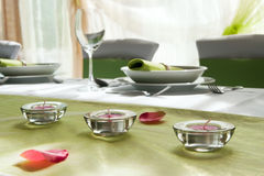 Wedding interior III. Wedding table set with composition of lamps and rose Stock Image