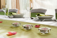 Wedding interior V. Wedding table set with composition of lamps and rose Royalty Free Stock Photo
