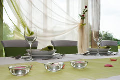 Wedding interior VIII. Wedding table set with composition of lamps and rose Stock Photography