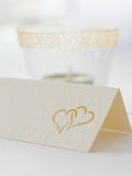 Wedding interior X. Place card macro with smoothed lamp Royalty Free Stock Photo