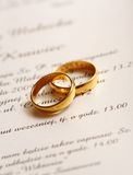 Wedding invitation. And two golden rings Royalty Free Stock Photography