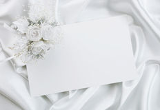 The wedding invitation. With a bouquet of the bride on a white background Royalty Free Stock Photography
