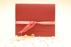 Wedding invitation. With ribbon and pearls stock photo
