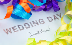 Wedding Invitation. Surrounded by colored ribbons Stock Photos
