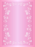Wedding invitation background. A wedding invitation background on pink with some leafs, creating a border frame for invitation Stock Photo