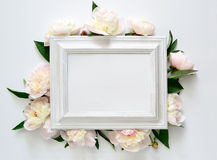 Wedding invitation. Or bridal shower invitation, white wooden frame decorated with flowers, blank space for a text Stock Photos