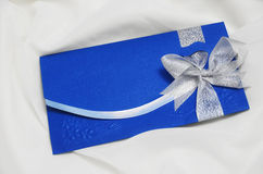 Wedding Invitation Card. Close up, full frame of blue wedding invitation card with silver ribbon Royalty Free Stock Image