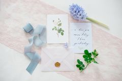 Wedding invitation card. As a decorated letter with flowers and ribbons top view Royalty Free Stock Photo