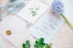 Wedding invitation card. As a decorated letter with flowers and ribbons top view royalty free stock images