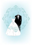 Wedding invitation card with clothes a bride and groom Royalty Free Stock Photography