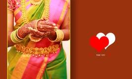 Wedding invitation card, groom puts bangle in bride hand at bangle ceremony stock photos