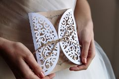 Wedding invitation card in hands. In rustic style stock images